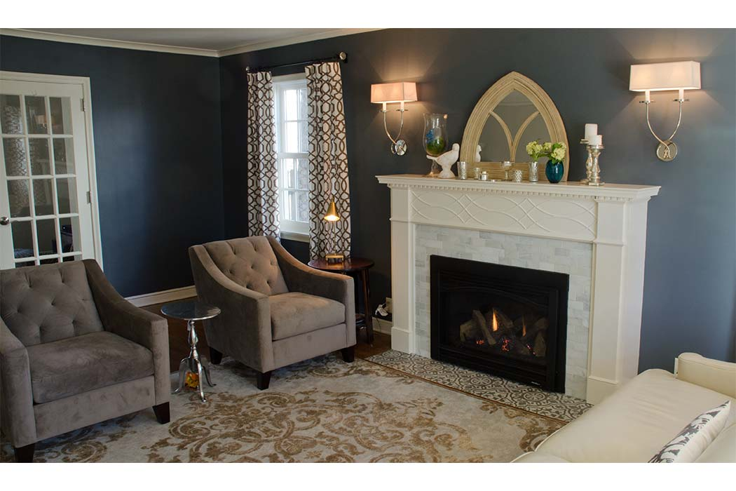 Carrera Marble Refreshes Living Room Fireplace