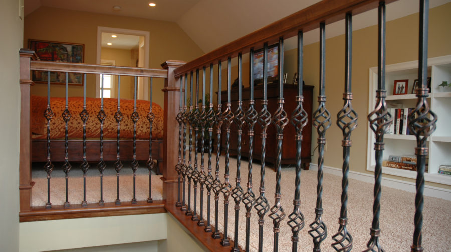 Jacobson Construction Wrought Iron Railing Adds Flair to Second Floor Bedroom